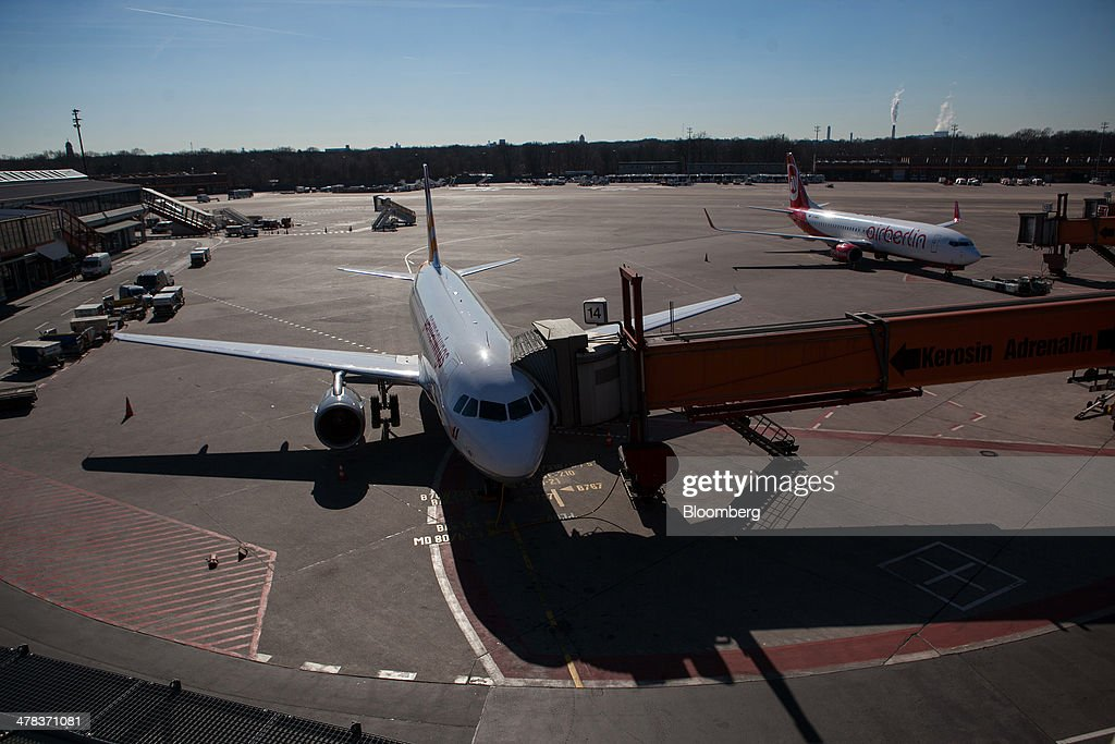 A Germanwings aircraft, a low-cost subsidiary of Deutsche Lufthansa AG, sits connected to a passenger walkway at Tegel airport, operated by Flughafen Berlin Brandenburg GmbH, in Berlin, Germany, on Wednesday, March 12, 2014. Berlin's Tegel airport has subsisted by chance alone, defying the odds as passenger growth outpaces every other major hub in Western Europe. Photographer: Krisztian Bocsi/Bloomberg via Getty Images
