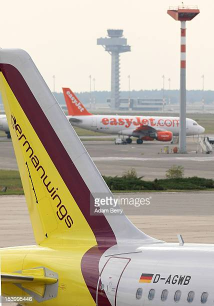Germanwings airplane sits on the tarmac as an Easyjet airplane prepares to take off at Schoenefeld airport on October 12 2012 near Berlin Germany...
