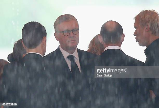 Germanwings head Thomas Winkelmann attends a memorial service in a tent under pouring rain for the last victims of Germanwings flight 4U9525 on July...