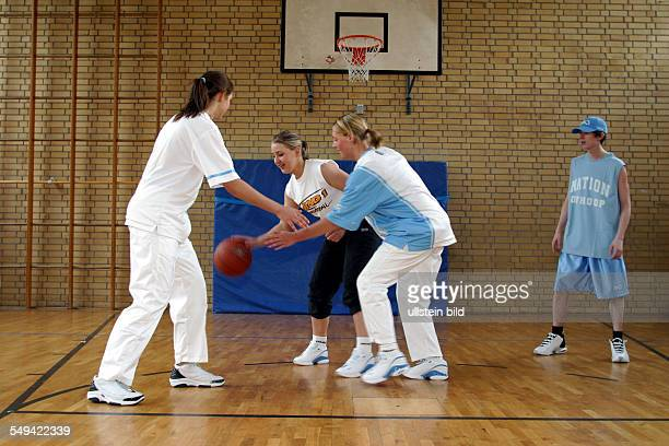 Free time/sport During a basketball match in a gymnasium