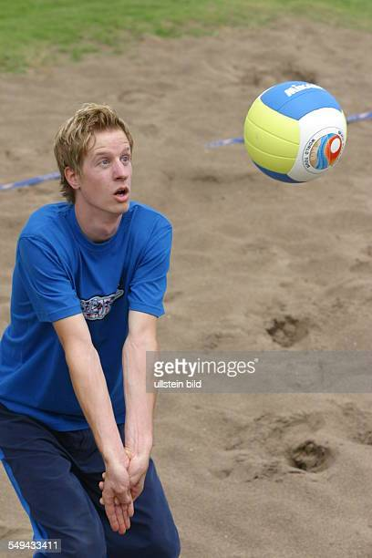 Holidays/beach A young man playing beach volleyball