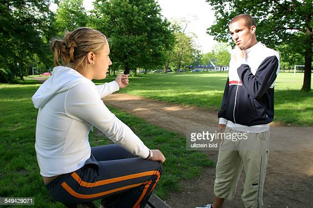 Free time Two young persons talking in a park