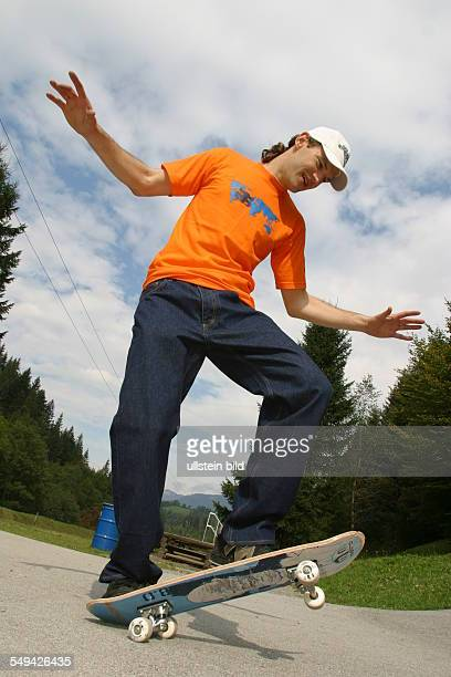 A young man skateboarding