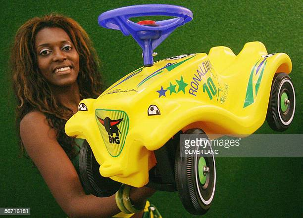 A fair hostess presents a 'Ronaldinho' Bobby Car to promote the International Toy Fair in Nuremberg southern Germany 01 February 2006 The fair that...
