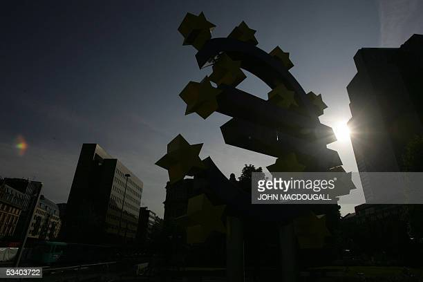 A giant Euro symbol the currency of the EU stands in front of Frankfurt's Eurotower which houses the European Central Bank taken 28 June 2005 AFP...