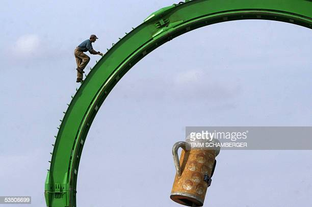 A man works on a roller coaster on 27 August 2005 in Munich in preparation of the southern city's world known Oktoberfest beer festival The first...