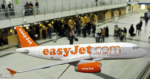 A model of an Airbus 319 of the British low cost airline easyJet hangs in the hall of Dortmund's airport 13 February 2004 Toby Nicol Marketing...