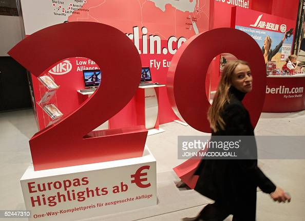 A visitor walks past a stand of German airline Air Berlin promoting low cost flights inside Europe at Berlin's International Tourism Fair 15 March...