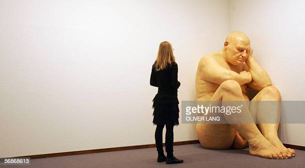 A woman contemplates the sculpture 'Untitled ' by Australian artist Ron Mueck 16 February 2006 at the Neue Nationalgalerie museum in Berlin From 17...