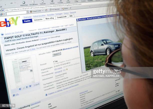 A woman looks on a screen displaying the internet site of eBay Germany selling Pope Benedict XVI's old Volkswagen 04 May 2005 at her office in Berlin...