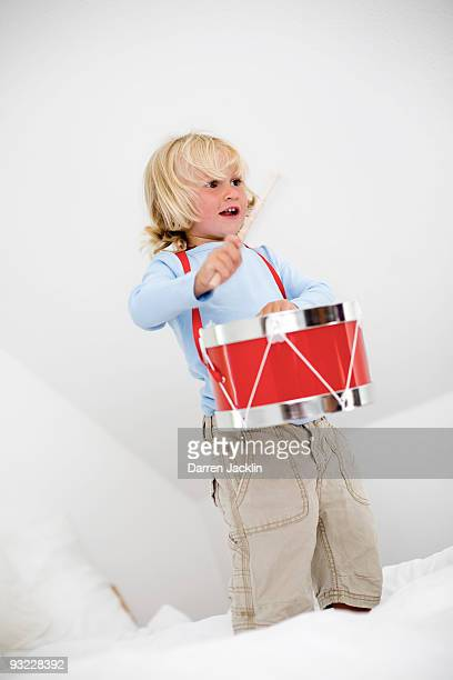 Germany, Ammersee, Diessen, Boy (2-3) playing with drum