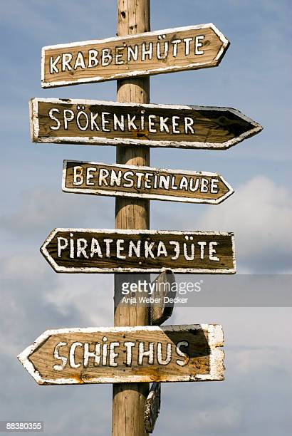Germany, Amrum, sign post against sky, close-up