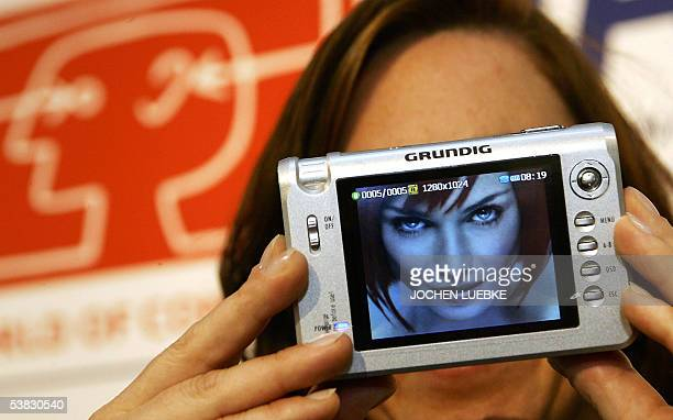 An employee of electronics products maker Grundig presents her company's new multimedia console on 01 September 2005 on the fairgrounds of the...