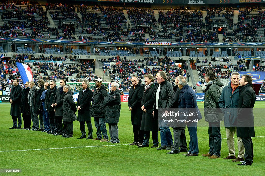 Germany and France players of 1982 line up on the pitch during a meeting of the 1982 World Cup teams of France and Germany on February 6, 2013 in Paris, France.
