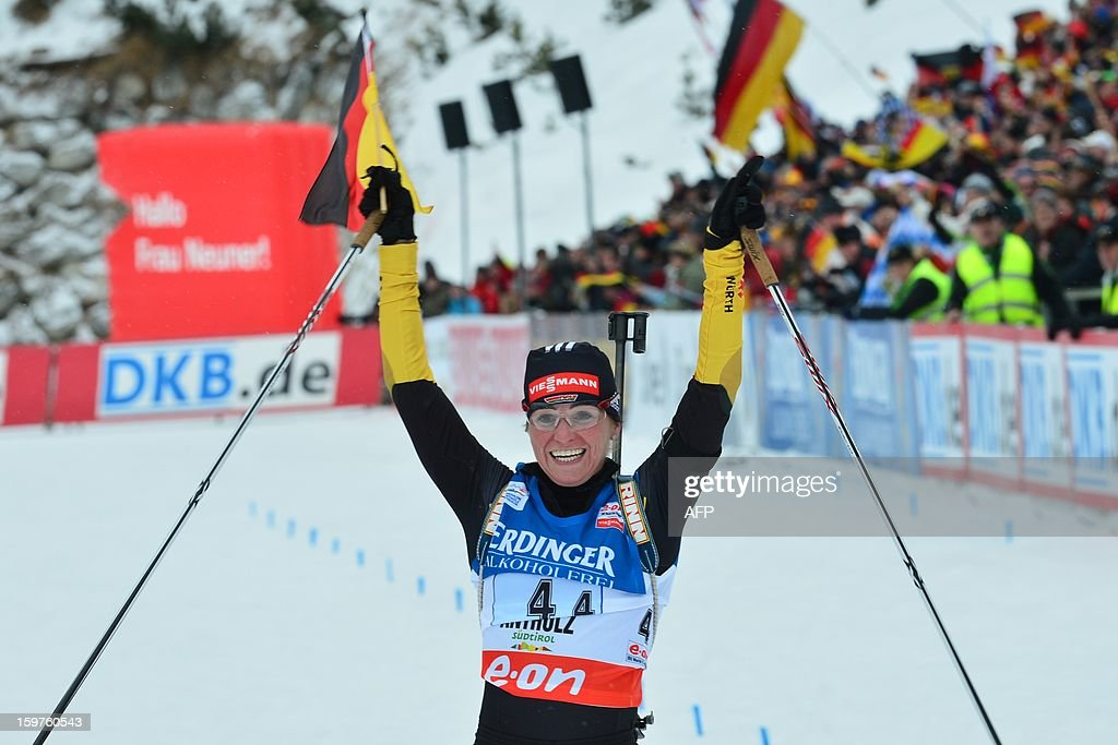 Germany Andrea Henkel celebrates on the finish line her yeam's first place in the 4x6 kilometers' relay race of the women's biathlon World Cup race on January 20, 2013 in Antholz-Anterselva.Germany team won ahead of Russia and France Ukraine.