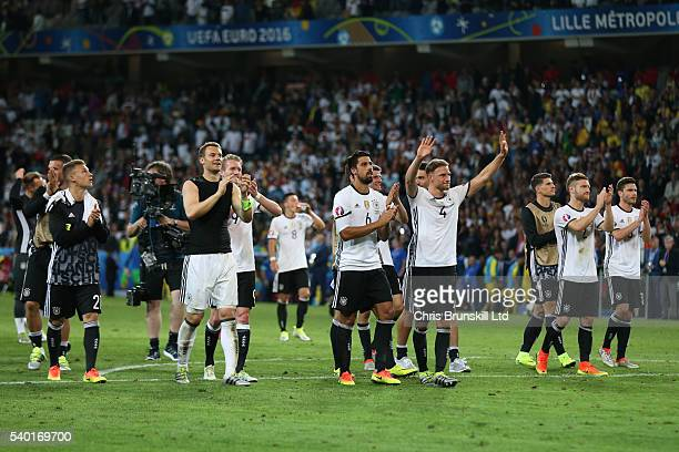 Germany applaud their supporters following the UEFA Euro 2016 Group C match between Germany and Ukraine at Stade PierreMauroy on June 12 2016 in...