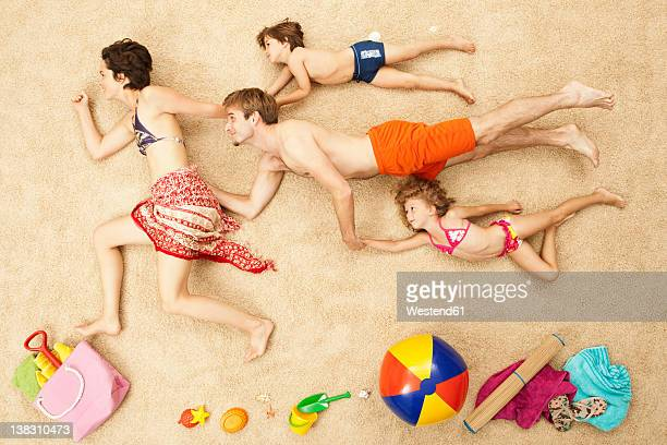 Germany, Artificial beach scene with family and beach toys