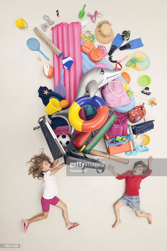 Germany, Artificial scene with children opening baggage full of beach toys