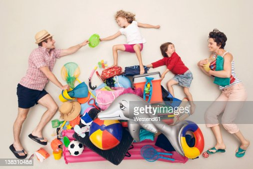 Germany, Artificial scene with family and beach toys