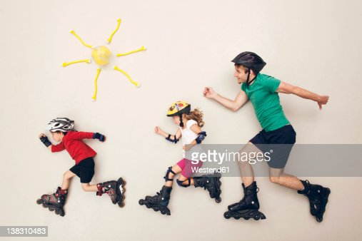 Germany, Artificial scene with family doing inline skating