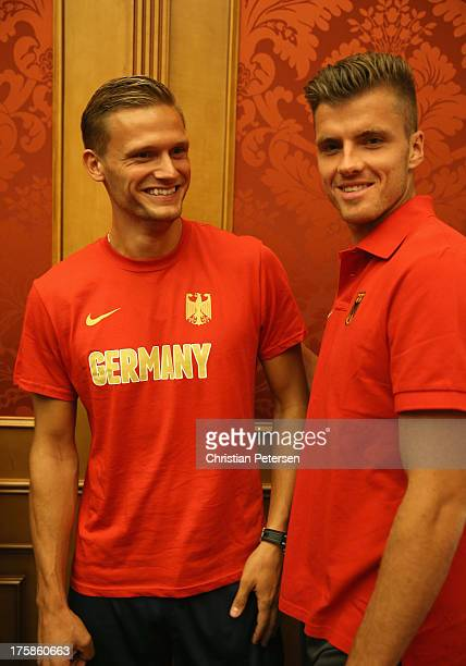 Germany athletes Pascal Behrenbruch and Rico Freimuth talk following a press conference ahead of the 14th IAAF World Championships at the Golden Ring...