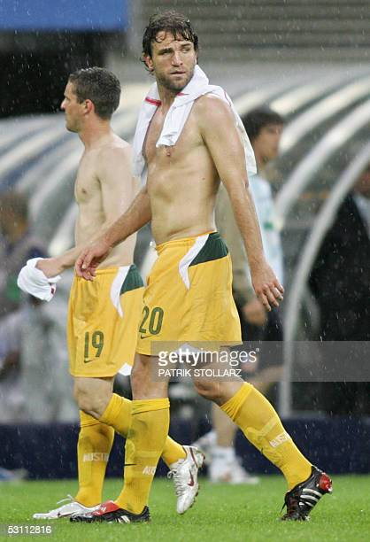 Australian midfielder Jason Culina and defender Ljubo Milicevic look dejected at the end of the Confederations cup football match Australia vs...