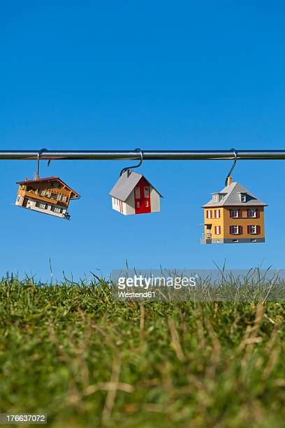 Germany, Baden Wuerttemberg, Stuttgart, House model hanging on steel rod