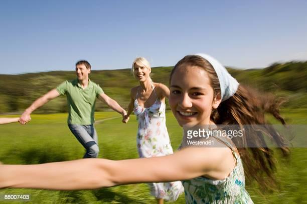 Germany, Baden Wuerttemberg, Tuebingen, family playing in meadow