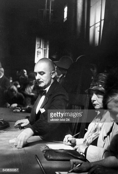 Germany BadenBaden Casino photographing with the candid camera the croupier at the roulette table published by Berliner Illustrirte Zeitung...