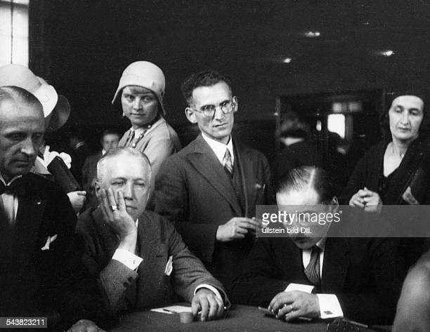 Germany BadenBaden Casino photographing with the candid camera two persons men showing nervousness at the roulette table 1930Photographer Wolfgang...