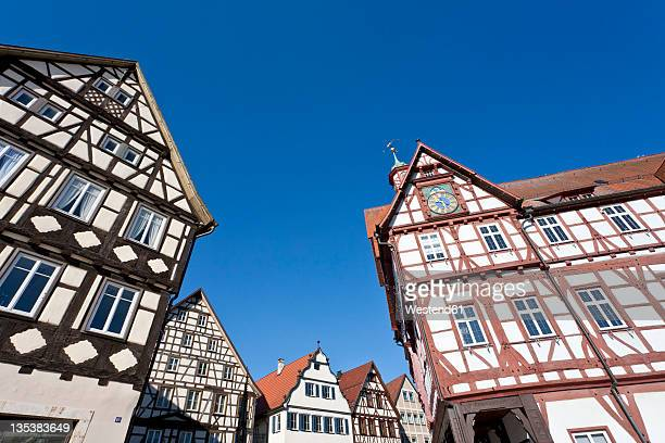 Germany, Baden-Württemberg, Bad Urach, View of frame houses and town hall