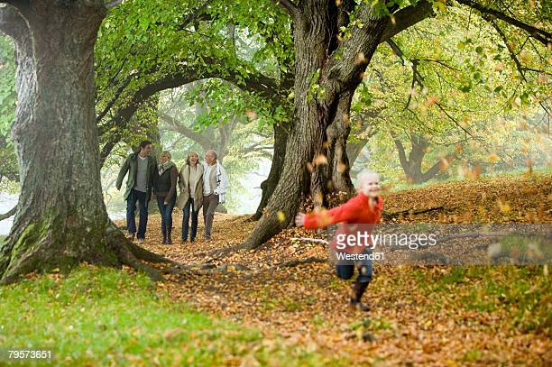 'Germany, Baden-W?rttemberg, Swabian mountains, Family walking together in forest'