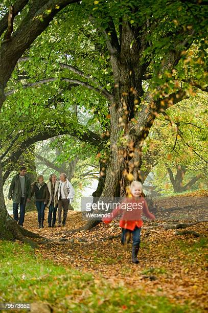 Germany, Baden-Württemberg, Swabian mountains, family walking together in forest, girl (6-7) running