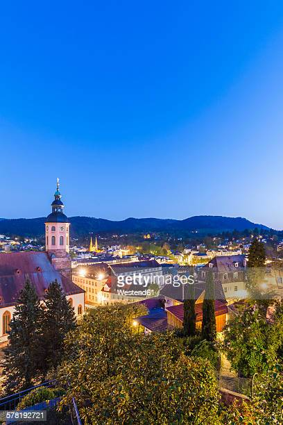 Germany, Baden-Wuerttemberg, Baden-Baden, Cityscape with collegiate church in the evening