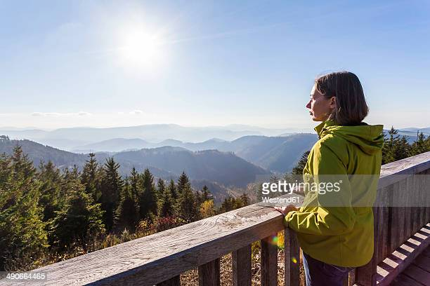 Germany, Baden-Wuerttemberg, Black Forest, Northern Black Forest, Schliffkopf, a woman standing at viewpoint