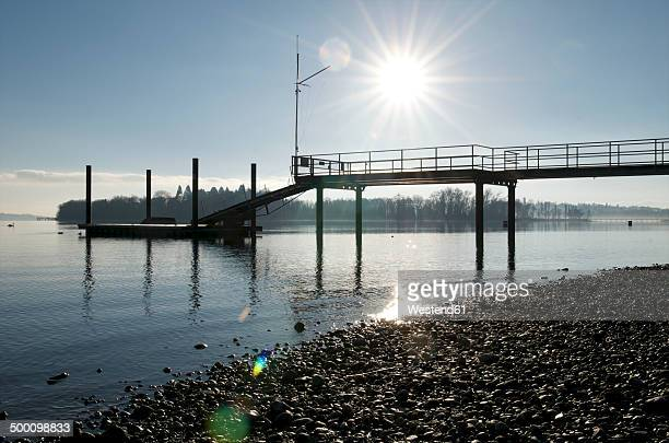 Germany, Baden-Wuerttemberg, Constance District, Lake Constance, Mainau, jetty against the sun