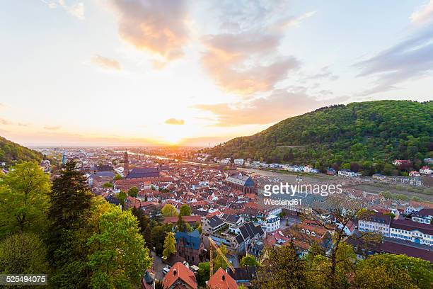 Germany, Baden-Wuerttemberg, Heidelberg, View to Old town and Old bridge against the evening sun