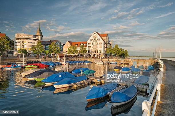 Germany, Baden-Wuerttemberg, Lake Constance, Friedrichshafen, covered boats at jetty