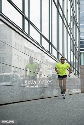 Germany, Baden-Wuerttemberg, Mannheim, mature jogger running in the city