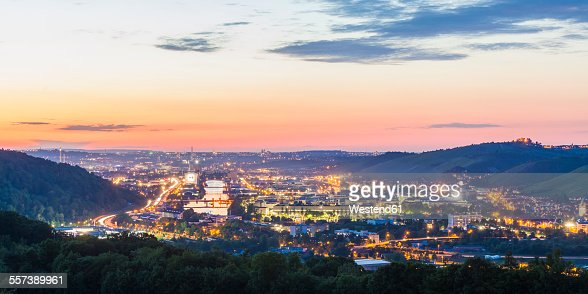 Germany, Baden-Wuerttemberg, Neckarvalley, River Neckar, View to Stuttgart with industrial area in the evening