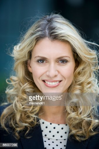 germany badenwuerttemberg stuttgart businesswoman smiling. Black Bedroom Furniture Sets. Home Design Ideas