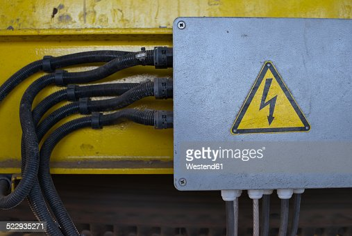 Germany, Baden-Wurttemberg, incinerator TREA Breisgau, cables and high voltage sign