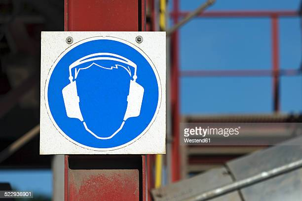 Germany, Baden-Wurttemberg, incinerator TREA Breisgau, Sign with ear protectors