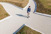 Germany, Baden-Wurttemberg, Teenage boy standing at crossing