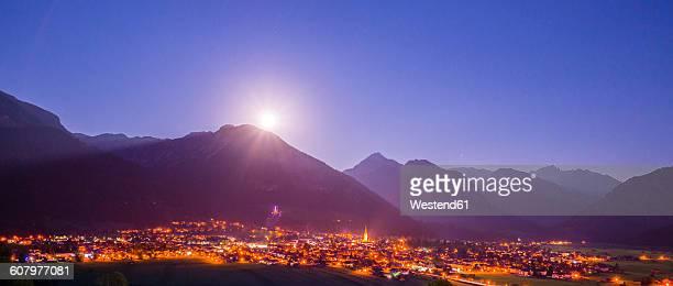 Germany, Bavaria, Allgaeu Alps, Oberstdorf at night, full moon