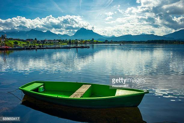 Germany, Bavaria, Allgaeu, East Allgaeu, Hopfen am See near Fuessen, Lake Hopfensee, green rowing boat