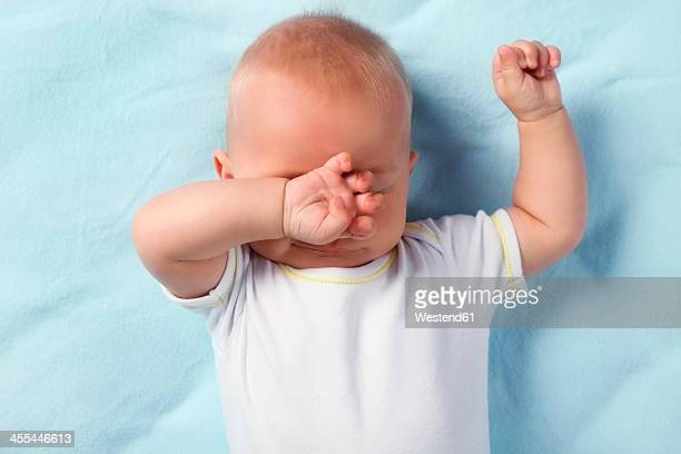 Germany, Bavaria, Baby boy rubbing eyes