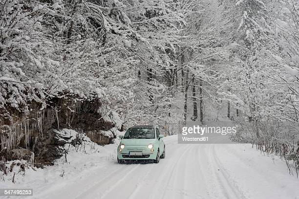 Germany, Bavaria, Berchtesgadener Land, car on rural road in winter landscape