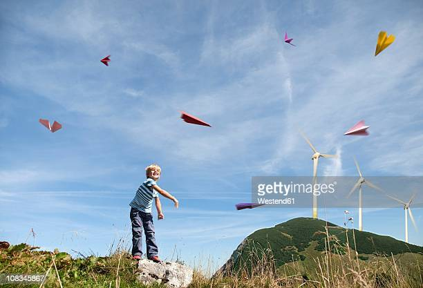 Germany, Bavaria, Boy (4-5 Years) playing with paper planes