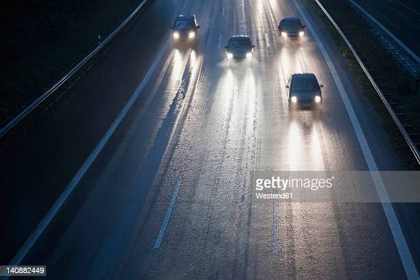 Germany, Bavaria, Cars on autobahn during rain